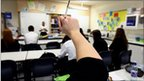 Pupils raises hand in lesson at school