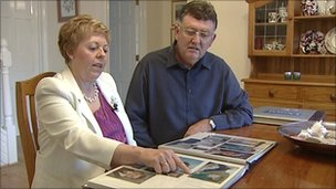 Matthew's parents looking at photo album