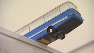 A maquette of a bus sculpture