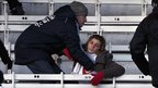 A woman receives amid clashes between River Plate fans and the police, 26 June 2011