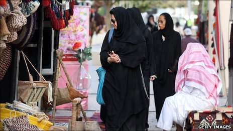 Saudi Women walk through a market