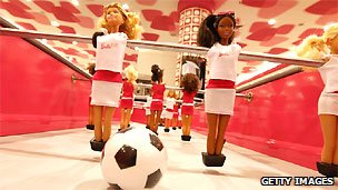 "A special edition football table featuring Barbie dolls - sold with the motto ""Barbie Loves DFB"" (German Football Federation)"