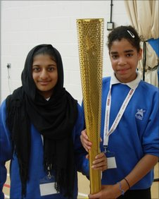 School Reporters holding a replica Olympic Torch