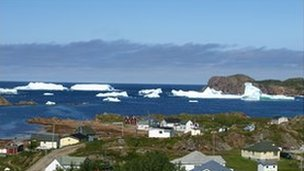 Icebergs surrounding a village