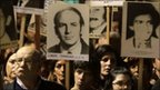 "Uruguayans display pictures of relatives who ""disappeared"" during the 1973-1985 period of military rule (20 May 2011)"