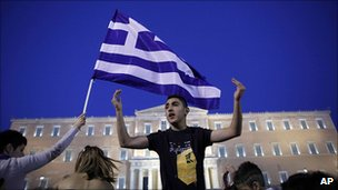 Protester outside parliament in Athens 26 June 2011