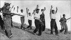 Soldiers of Gen Franco's Nationalists escort captured Republican troops in the Spanish Civil War