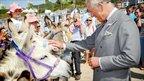 Prince Wales meets a donkey