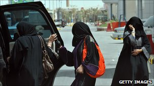 Saudi women enter car in defiance of a law banning female drivers
