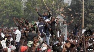 Demonstrators protest next to Senegal's parliament building in Dakar on 23 June 2011