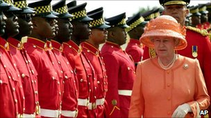 Queen Elizabeth II inspects a guard of honour in Kingston, Jamaica (19 Feb 2002)