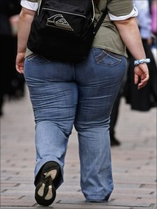An overweight person walks through Glasgow City centre 