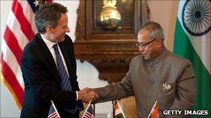US Treasury Secretary Tim Geithner and Indian Finance Minister Pranab Mukherjee shake hands