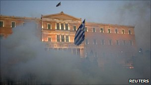 Tear gas clouds surround the Greek parliament
