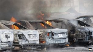 Burning vehicles in police HQ car park