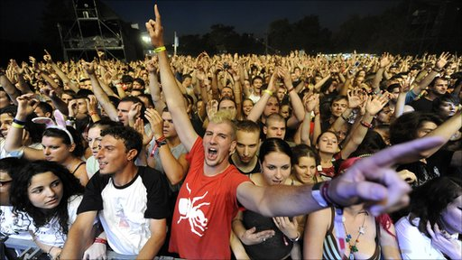 Revellers cheer during a concert at the annual EXIT music festival in the northern Serbian city of Novi Sad (2010)