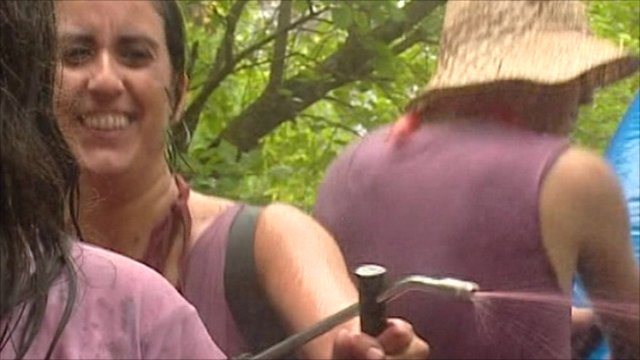 Woman fires red wine from a pump