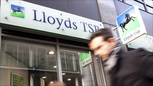 Man walks past Lloyds
