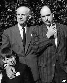 Greek Prime Minister George Papandreou as a young boy posing together with his late father Andreas (right) and grandfather George (left) - both former Greek prime ministers