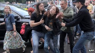 Plain clothed Belarusian policemen arrest opposition supporters during a rally in central Minsk on Wednesday