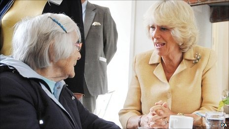 The Duchess of Cornwall talks to Mary Bennett, 101, at Llandovery railway station