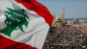 A Lebanese flag waves as thousands of protesters gather in Martyrs Square, central Beirut, Lebanon, March 14, 2005
