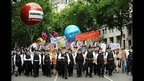Police officers lead the two-mile procession