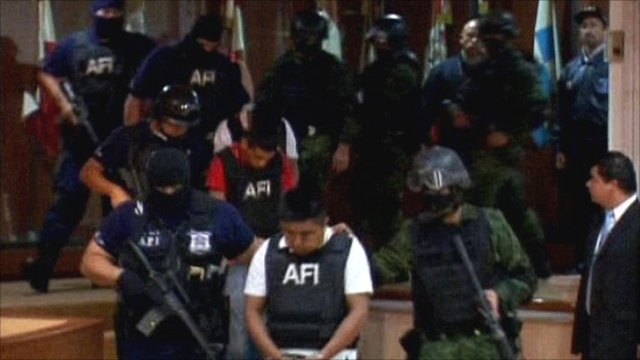 Abraham Barrios Caporal escorted by police
