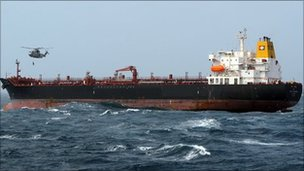 Helicopter winches crewman from stricken tanker