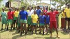 Children from Waldensia Primary school in Jamaica perform a song composed for their Olympic Dreams partnership.