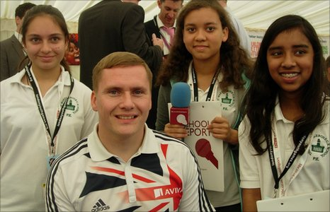 School reporters Zara, Charis and Tharini with David Weir