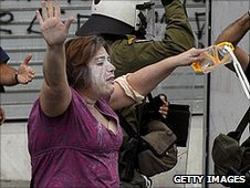 Riot policemen scuffle with women during a 48-hour general strike in Athens