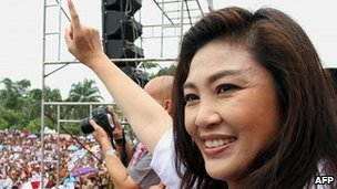 Yingluck Shinawatra,  sister of fugitive former Thai prime minister Thaksin Shinawatra, waves to supporters 29 June 29