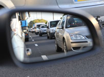 Traffic in car wing mirror