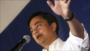 Thai Prime Minister Abhisit Vejjajiva addresses a campaign rally 23 June 2011