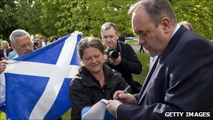 Alex Salmond gives an autograph