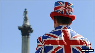 Street performer wearing a union flag suit