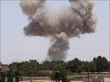 Smoke billows from a spot targeted by a NATO air strike on July 1, 2011 in the Tripoli suburb of Tajura,