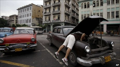 A man checks his old car in Havana on 1 July 2011