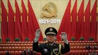A Chinese military band conductor rehearses ahead of the celebration of the Communist Party's 90th anniversary