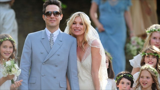 Kate Moss with her new husband Jamie Hince after their wedding at St Peter&#039;s Church in Southrop