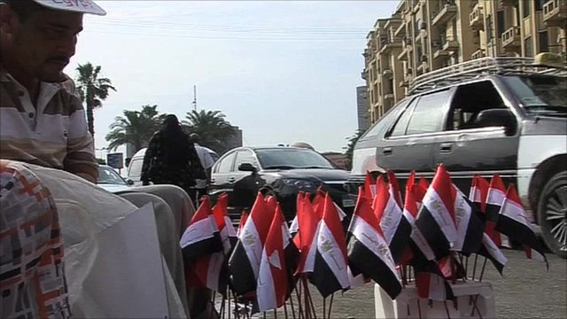 Man selling Egyptian flags on Cairo street
