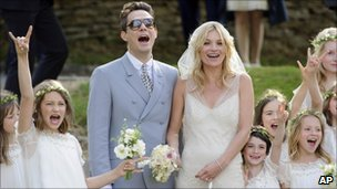 Jamie Hince and Kate Moss with bridesmaids