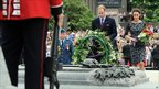Prince William and his wife Catherine, the Duchess of Cambridge, place a wreath at the National War Memorial in Ottawa...