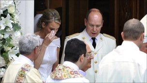 Princess Charlene wipes a tear as she leaves the St Devote's Church where she left her bouquet after their religious wedding.