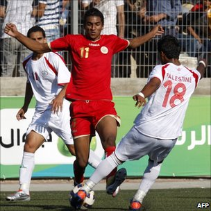 Palestinian and Bahraini players during their 2012 Olympic qualifying football match in the West Bank town of Al-Ram, near Ramallah, on June 23, 2011