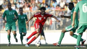 Afghanistan's Mohammad Yusef Mashriqi (C) runs with the ball during the 2014 World Cup first round second leg qualifying match against Palestine , 3 July 3 2011