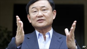 Thaksin Shinawatra speaks to reporters in Dubai (4 July 2011)