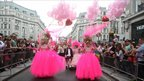 Revellers take to the streets in central London for the annual Gay Pride parade.