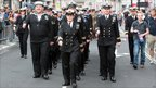 Members of the armed forces take part in the annual Gay Pride parade, in central London
